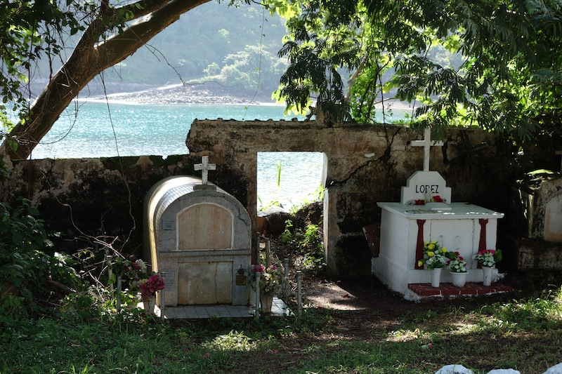 two older graves along the wall of the seaside cemetery at Taboga Panama