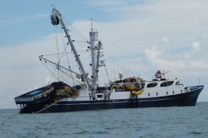 Tuna fishing vessel named Taurus Tuna at anchor in Panama.