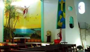 inside Catholic church local art palm trees tortoise stained glass bluefooted booby frigatebird