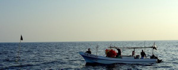 40 miles offshore, these fishermen came to steer us around their long lines.