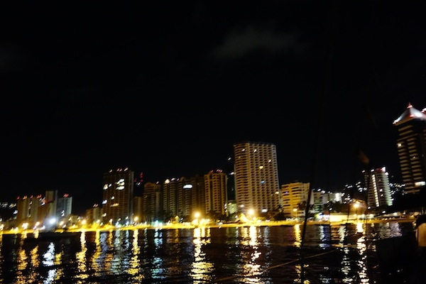 City lights but empty waterfront high-rises.