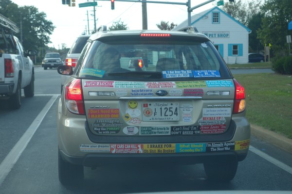 My guess from all the evidence is that this car is owned and decorated by a woman.