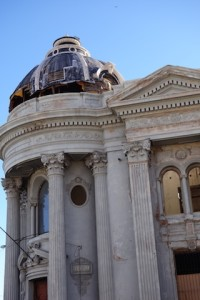 Guaymas 1900s era bank building columns, cornices and dome, in disrepair.