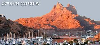 sunlit mountains marina foreground