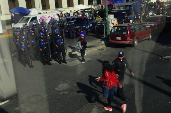 Group of Mexico City policemen with clear plastic shields