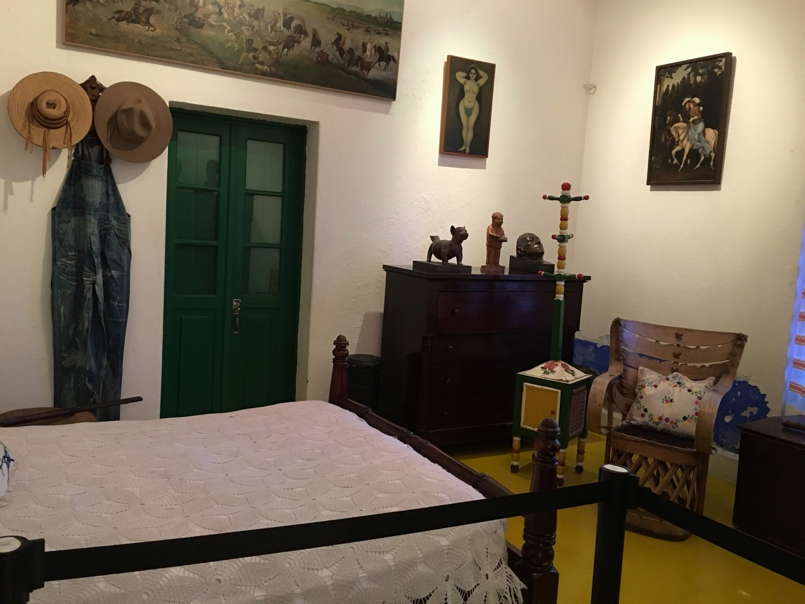Diego had a room downstairs. Those are his overalls and hats on the wall.
