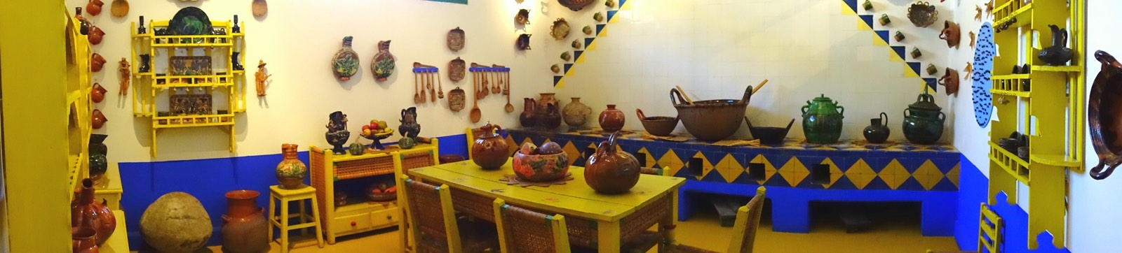 Yellow kitchen, lots of pre-Columbian Mexican art.