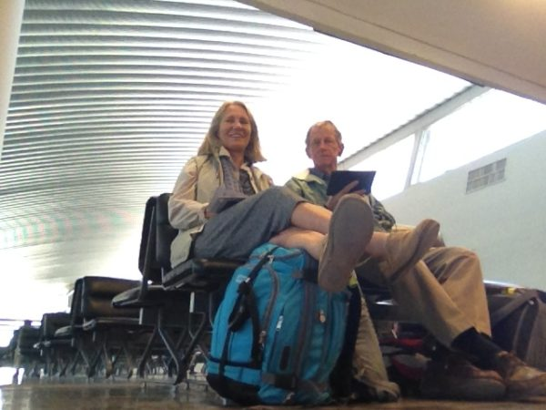 In our travelling rigs, we wait patiently (good internet available) for our flight to Mexico City..